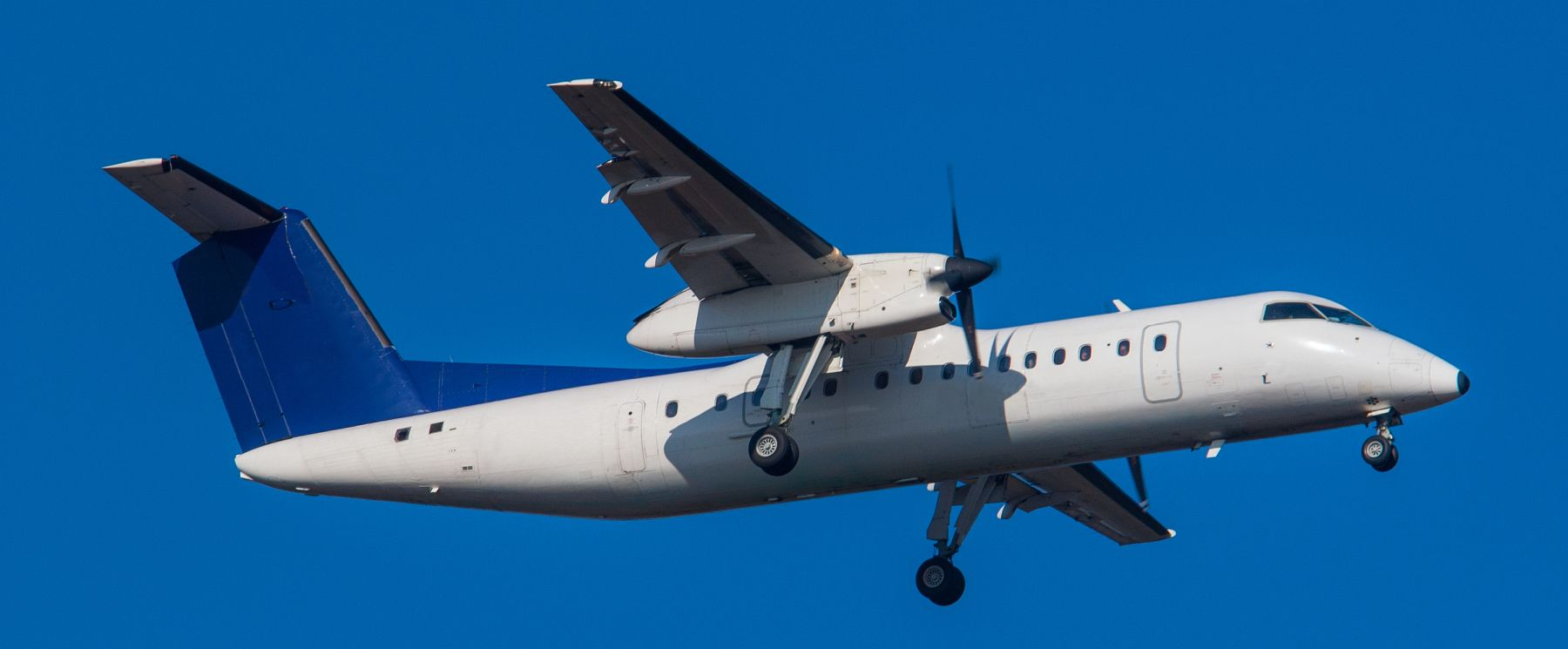 a dash 8 flying in the sky