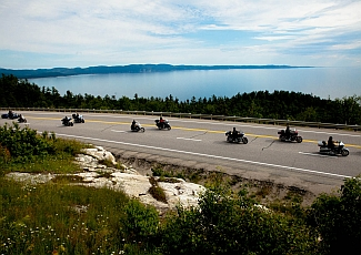 motorcycles riding on the shore of lake superior near thunder bay