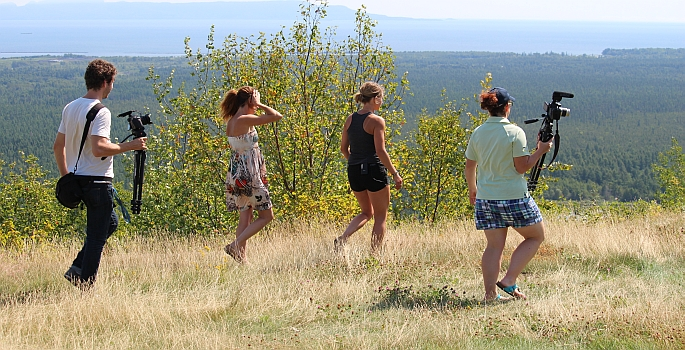 a group walks near the scenic lookout at mount mckay